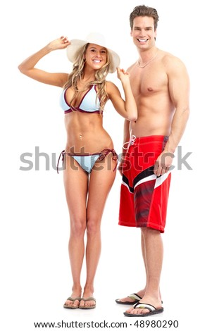 Happy smiling couple in swimming suits. Isolated over white background