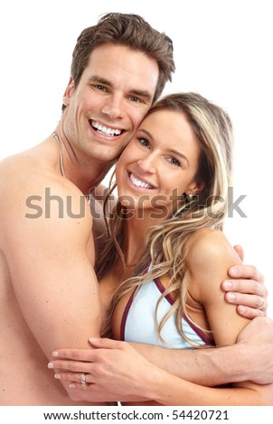 Happy smiling couple in swimming suits. Isolated over white background - stock photo