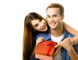 Happy smiling couple with red gift box, close to each other and looking at camera with smile. Caucasian models, isolated on white. Holidays sales shopping, discounts, rebates, trade deals concept.