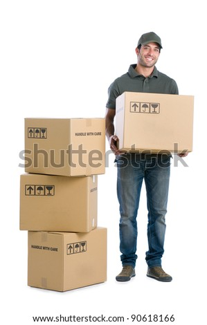 Happy smiling delivery man carrying boxes isolated on white background