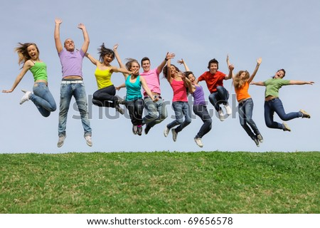 Happy smiling diverse group of jumping teenager people