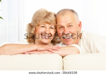 Happy smiling elderly couple at home - stock photo