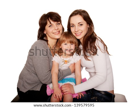 Happy smiling family, mother and two daughters, a teenager and a toddler. Isolated on white background
