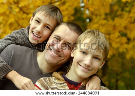 Happy smiling family relaxing in autumn park #244884091