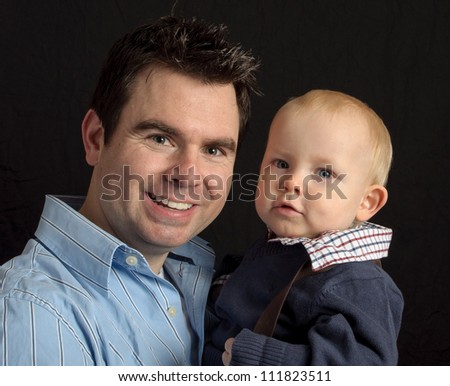 happy smiling father with his young son portrait