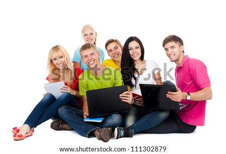 Happy smiling friends, group of young people standing and embracing together isolated on white background