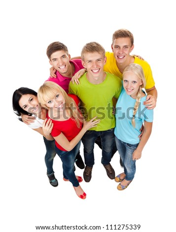 Happy smiling friends, group of young people standing and embracing together top angle view full length portrait isolated on white background