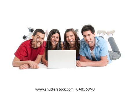 Happy smiling friends working together at laptop computer isolated on white background - stock photo