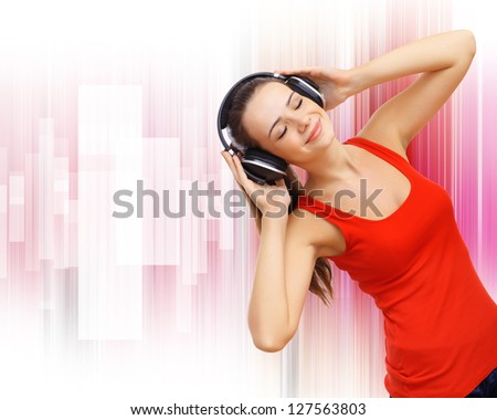 Happy smiling girl dancing and listening to music
