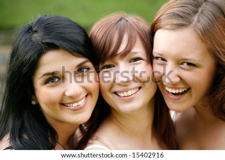 happy smiling girl friends outdoor