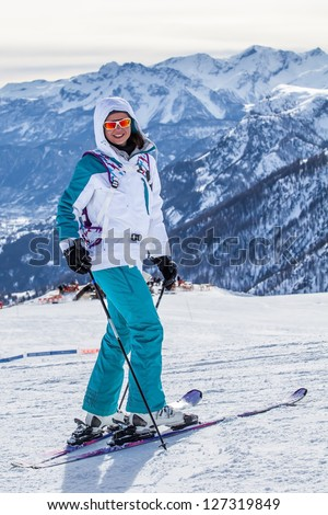 Happy smiling girl in ski. Focus on the girl
