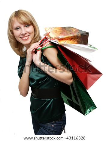 Happy smiling girl shopping with colored bags.