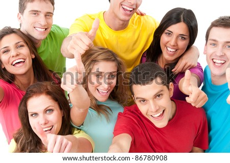 Happy smiling group of joyful friends showing thumb up isolated on white background