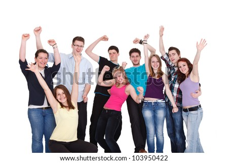 Happy smiling group of young friends standing and embracing together on white background