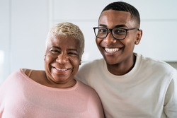 Happy smiling Hispanic mother and son portrait - Family love and unity concept