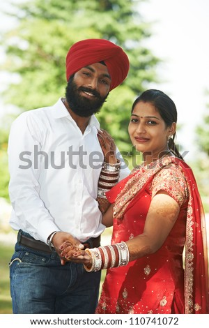 Happy Smiling indian young people couple just married after wedding