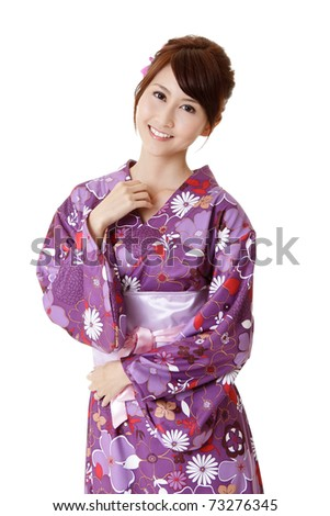 Happy smiling Japanese beauty in traditional clothes, closeup portrait on white background.