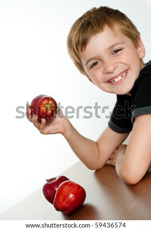 Happy Smiling Kid Holding Delicious Red Apple