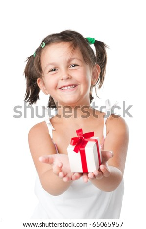 Happy smiling little girl holding and offering a gift for Christmas and birthday isolated on white background