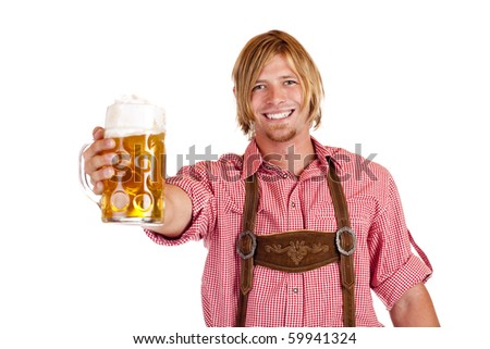 Happy smiling man with leather trousers (lederhose) holds oktoberfest beer stein. Isolated on white background.