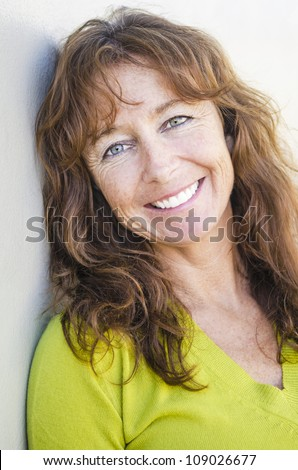 stock photo happy smiling mature woman with long auburn hair and freckles wearing a lime green jumper 109026677 There are 6 Victor Mature magazine covers on the site, please take a look by ...
