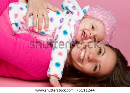 Happy smiling mother and child