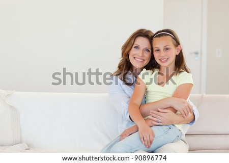 Happy smiling mother and daughter embracing