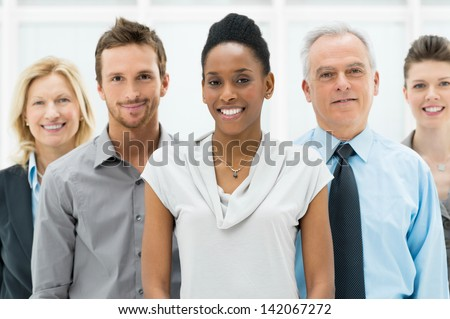 Happy smiling multi ethnic business team in office #142067272