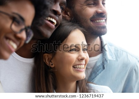 Happy smiling multiethnic friends having fun together close up, diverse multiracial young people, colleagues, students posing for photo, embracing, multiracial friendship concept
