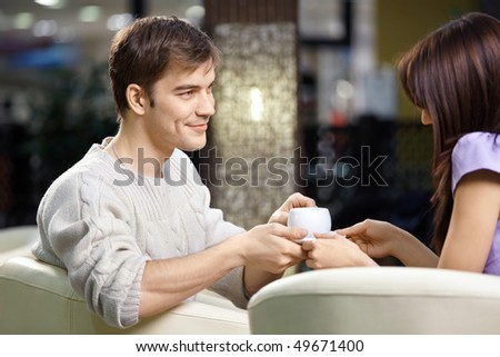 Happy smiling pair of the enamoured have dinner in cafe