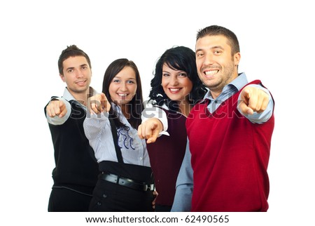 Happy smiling people group pointing to you and making selection isolated on white background