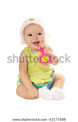 Happy smiling pretty baby girl with rattle isolated on white background