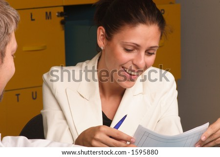 Happy,smiling secretary, talking to a man - close up