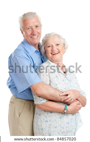 Happy smiling senior couple standing together with an embrace isolated on white background