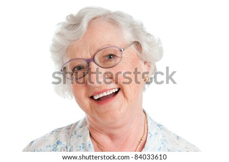 Happy smiling senior lady looking at camera with her glasses isolated on white background