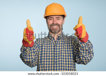 Happy smiling successful builder with thumbs up gesture. - stock photo