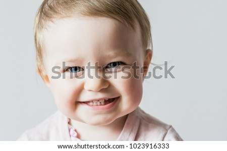 Happy smiling toddler girl portrait isolated closeup. Beautiful child with blue eyes. childhood, portrait, baby psychology, kid education, eyesight, healthy baby concepts