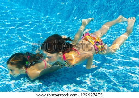 Happy Smiling Underwater Children In Swimming Pool ...