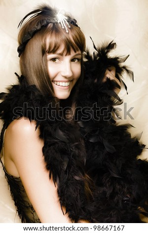 Happy Smiling Vintage Cabaret Girl Wearing Black Feather Scarf And Jewelry While Performing The Cancan In A Desaturated Image From The Classical 1920s Era - stock photo