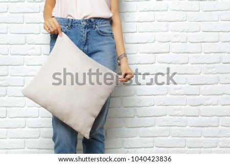 Happy smiling woman holding pillow #1040423836