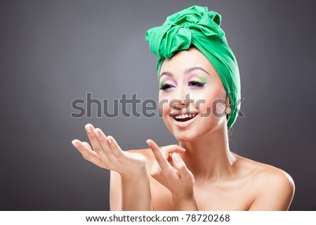 Happy smiling woman invite pointing witn finger