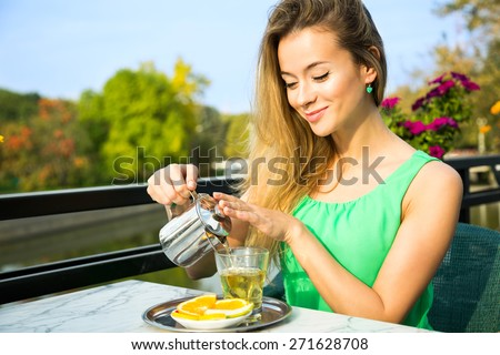 Happy Smiling Woman Making Green Tea Outdoors. Summer Background. Healthy Eating Concept. Shallow Depth of Field.  #271628708