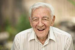 Happy smiling 90 year old elder senior man portrait