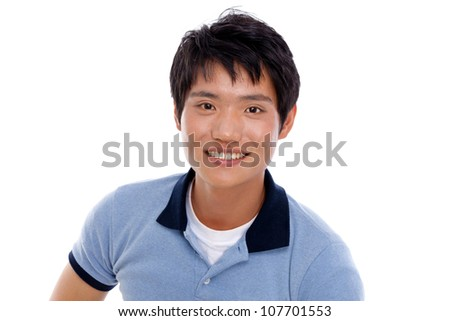Happy smiling young Asian man show thumb isolated on white background.