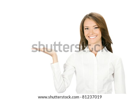 Happy smiling young beautiful business woman showing blank area for sign or copyspase, isolated on white background