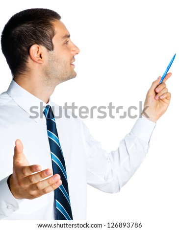 Happy smiling young business man showing blank area for sign or copyspace, isolated over white background