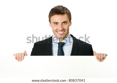 Happy smiling young business man showing blank signboard, isolated on white background - stock photo