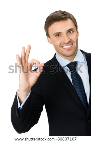 Happy smiling young business man with okay gesture, isolated on white background