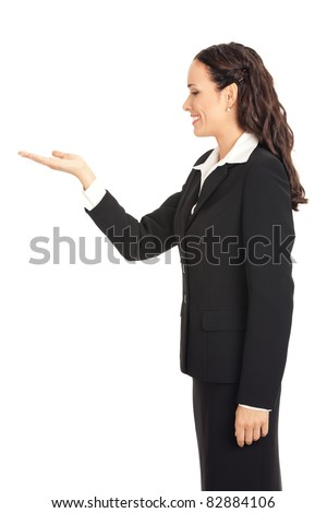 Happy smiling young business woman showing blank area for sign or copy space, isolated on white background