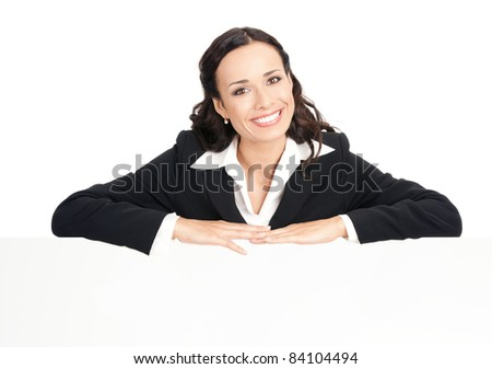 Happy smiling young business woman showing blank signboard, isolated over white background